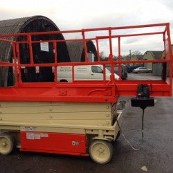 Red scissor lift