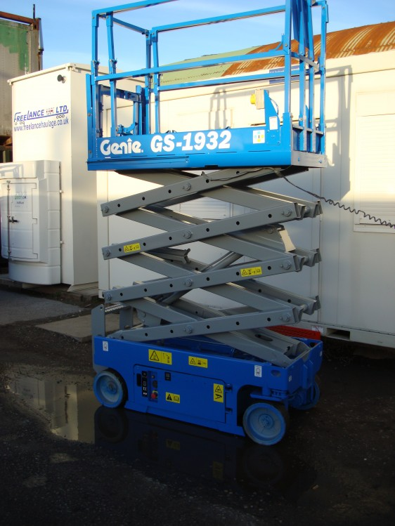 Blue Genie scissor lift in the elevated position for sale