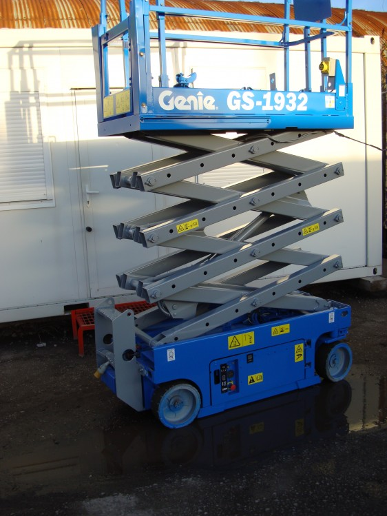 Blue Genie scissor lift in the elevated position