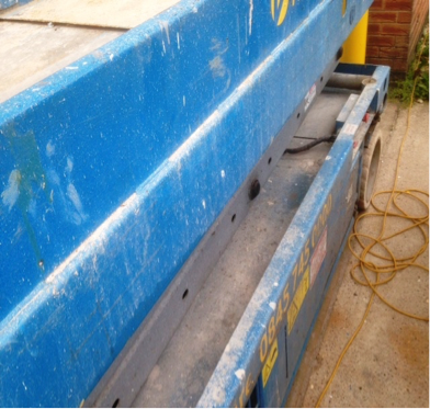 Close up of the paint work on the Genie scissor lift