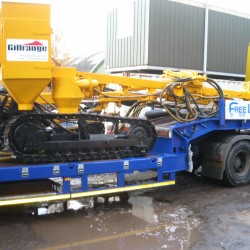 flatbed truck with loaded machinery