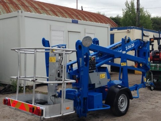 Genie lift with towing capability